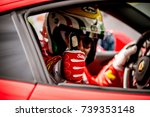 Small photo of Vallelunga, Italy september 24 2017. Motorsport Ferrari touring car racing driver thumbs up close up in cockpit