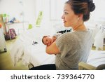 happy young mother with newborn ... | Shutterstock . vector #739364770