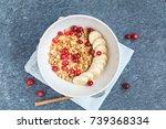muesli with banana and berries... | Shutterstock . vector #739368334