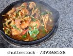 Small photo of Closeup fried fish with spicy sauce and herb (garlic , chili , basil , lesser galangal ) in hot pan