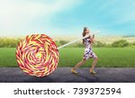 girl drags a huge colorful candy | Shutterstock . vector #739372594
