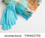 blue gloves and scarf on wooden ... | Shutterstock . vector #739402750