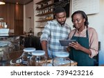 two young african entrepreneurs ... | Shutterstock . vector #739423216
