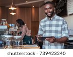portrait of a smiling african... | Shutterstock . vector #739423240