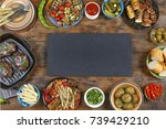 dinner table. various snacks of ... | Shutterstock . vector #739429210