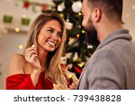 people sharing christmas wafer... | Shutterstock . vector #739438828