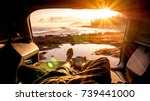 travel guy laying in the auto... | Shutterstock . vector #739441000