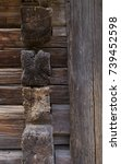 Small photo of detail of old wooden blockhouse, 18th century. Logs from the side abd the front