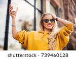 stylish happy young woman...   Shutterstock . vector #739460128