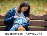 young mother  breastfeeding her ... | Shutterstock . vector #739462078