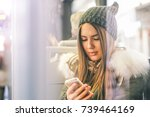 young woman using her smart...   Shutterstock . vector #739464169