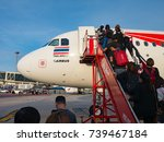 Small photo of Phuket, Thailand - October 17, 2017 - The passenger are getting on plane flight FD 3036 (Thai Air Asia airline : HS - ABG) at Phuket International Airport , from Phuket (HKT) to Donmuang Bangkok (DMK)