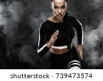 a strong athletic  woman... | Shutterstock . vector #739473574