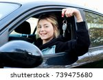 girl sitting in her car and... | Shutterstock . vector #739475680