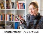 Young Girl Reading E Book...