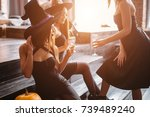 three girls sit and clink... | Shutterstock . vector #739489240