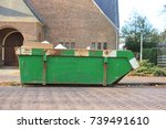 loaded dumpster near a... | Shutterstock . vector #739491610