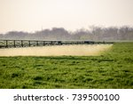 tractor with high wheels is... | Shutterstock . vector #739500100