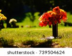 A Grave Marked With Flowers In...