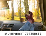 autumn car trip. woman feet in... | Shutterstock . vector #739508653