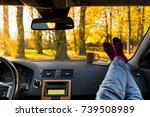 autumn car trip. woman feet in... | Shutterstock . vector #739508989