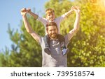 the son sit on the neck of... | Shutterstock . vector #739518574