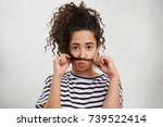 funny female pouts lips  puts... | Shutterstock . vector #739522414