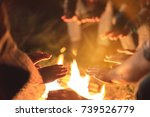 the people warming hands near a ... | Shutterstock . vector #739526779