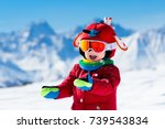 child skiing in the mountains.... | Shutterstock . vector #739543834