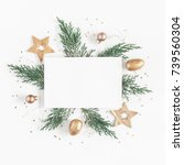 Small photo of Christmas composition. Paper blank, christmas tree branches, golden decorations on white background. Flat lay, top view, copy space, square.