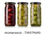 olives  in glass jar isolated...   Shutterstock . vector #739579690