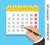 calendar on the wall and hand... | Shutterstock .eps vector #739599718