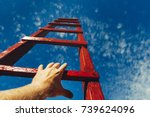 hand of man reaching for red... | Shutterstock . vector #739624096