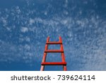 red staircase rests against... | Shutterstock . vector #739624114