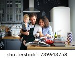 young family preparing lunch in ... | Shutterstock . vector #739643758