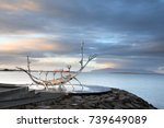sun voyager monument  clouds ...   Shutterstock . vector #739649089