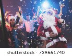 a man dressed as santa claus... | Shutterstock . vector #739661740