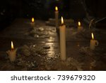 candles burn in the dark dirty... | Shutterstock . vector #739679320