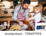 young family making cookies at... | Shutterstock . vector #739697593