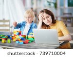 adorable little boy playing... | Shutterstock . vector #739710004