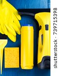 yellow cleaning supplies on a... | Shutterstock . vector #739715398