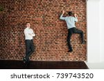 the groom in a white shirt is... | Shutterstock . vector #739743520