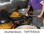 man cooking in a dirty...   Shutterstock . vector #739755310