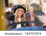 Happy Young Women Taking Selfi...