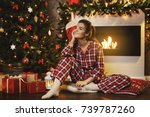 happy woman wearing checkered... | Shutterstock . vector #739787260