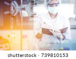 young asian scientist with test ... | Shutterstock . vector #739810153