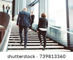 modern business people walking... | Shutterstock . vector #739813360