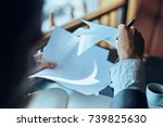 documents in hand  business    ... | Shutterstock . vector #739825630