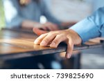 the man's hand on the table     ... | Shutterstock . vector #739825690