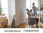 happy caucasian family moving... | Shutterstock . vector #739849909